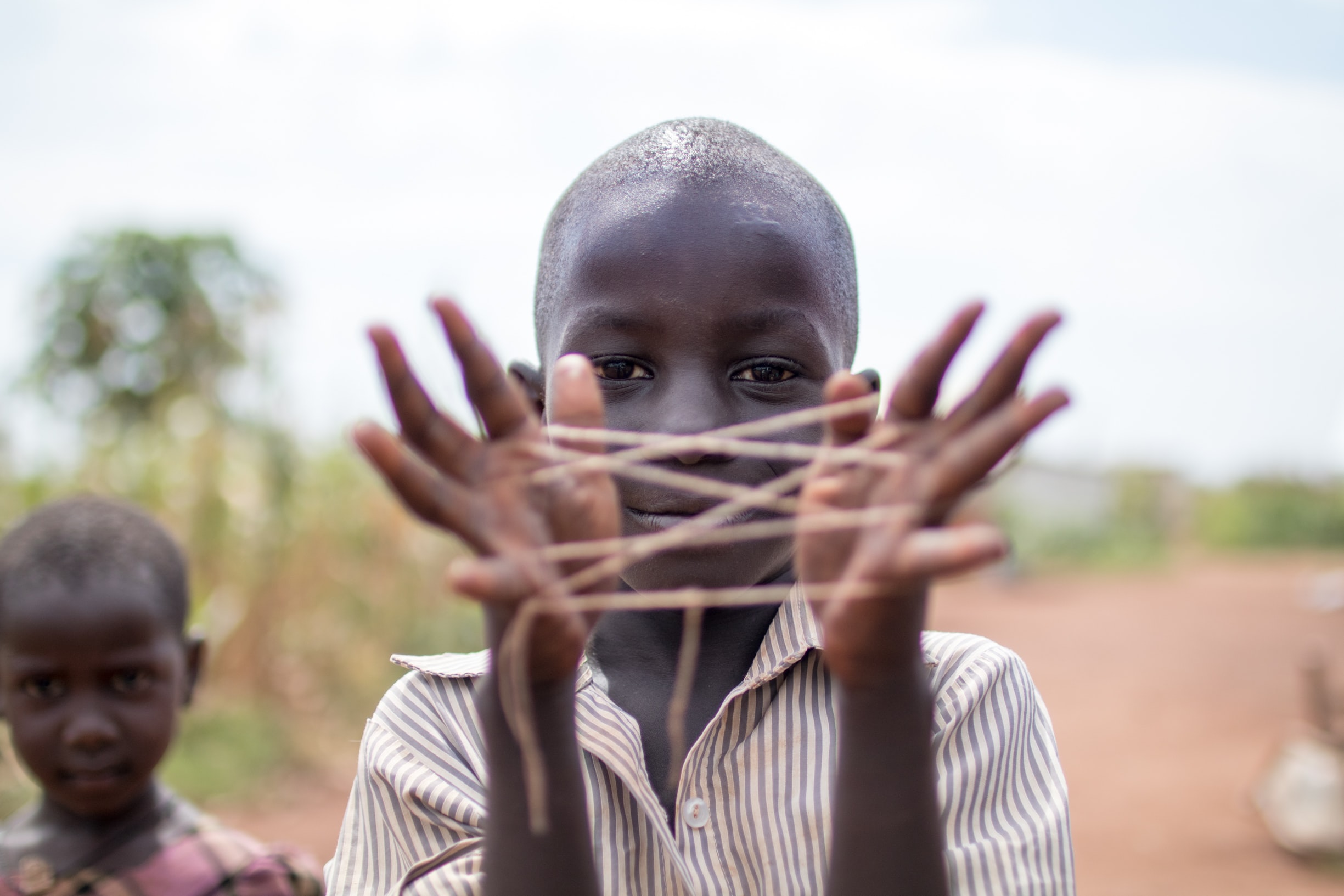 Ugandan Child Playing a Game