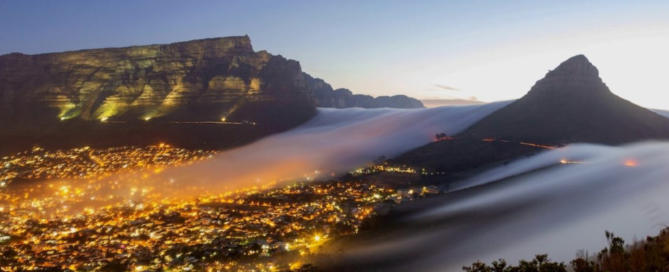scene of cape town at night against backdrop of table mountain