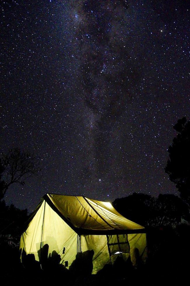 illuminated tent in front of night sky on Mount Kilimanjaro